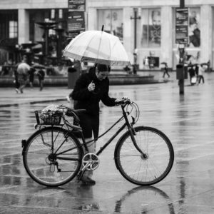 Woman, Umbrella, Bike | by kohlmann.sascha, flickr.com